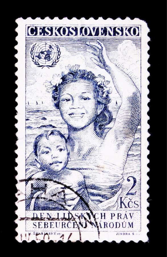 MOSCOW, RUSSIA - JUNE 20, 2017: A stamp printed in Czechoslovakia shows woman with child, Day of human rights, circa 1950 stock image