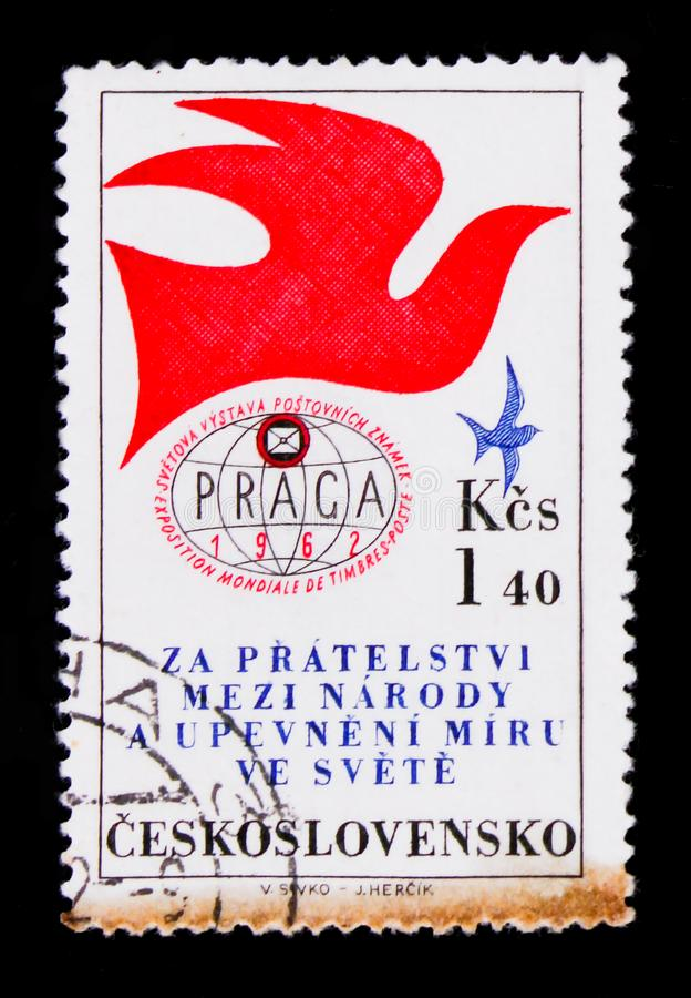 MOSCOW, RUSSIA - JUNE 20, 2017: A stamp printed in Czechoslovakia shoe globe and pigeon, devoted to international exhibition of p. Ost stamps, Prague, circa 1962 stock images