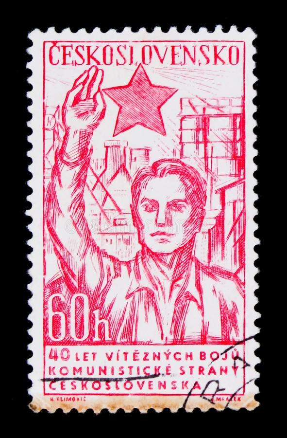 MOSCOW, RUSSIA - JUNE 20, 2017: A stamp printed in Czechoslovakia shows man saluting red star, 40 anniversary of communist. Party, circa 1961 royalty free stock photos
