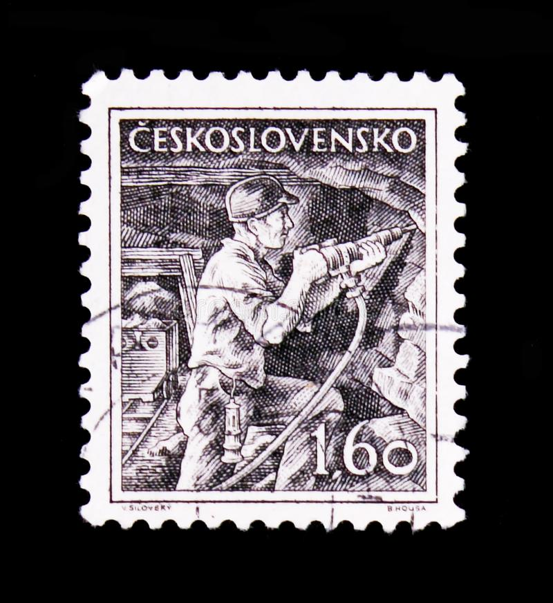 MOSCOW, RUSSIA - JUNE 20, 2017: A stamp printed in Czechoslovakia shows miner, circa 1954 royalty free stock photo