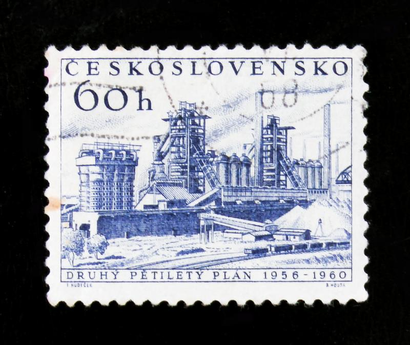 MOSCOW, RUSSIA - JUNE 20, 2017: A stamp printed in Czechoslovakia shows shows oil refinery; new five year plan, circa 1960 stock images