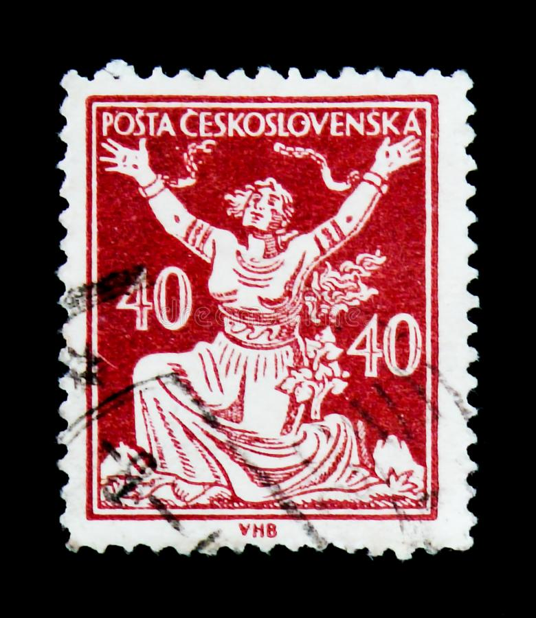 MOSCOW, RUSSIA - JUNE 20, 2017: A stamp printed in Czechoslovakia shows woman breaking chains to Freedom, circa 1920 stock photos