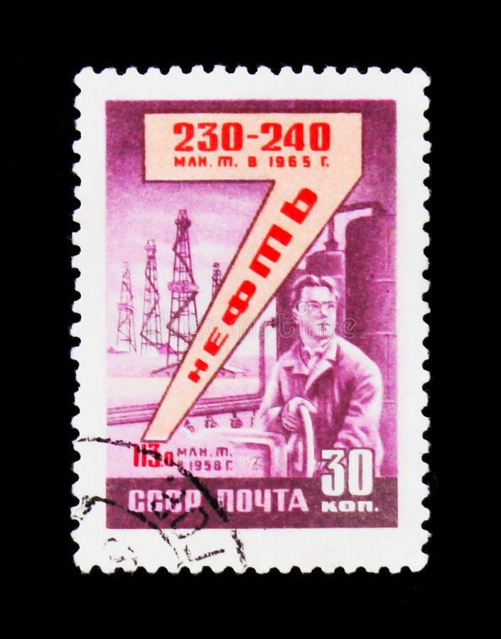 Oil refinery, shows man by the machine, circa 1958. MOSCOW, RUSSIA - JUNE 26, 2017: A stamp printed in USSR Russia devoted to Oil refinery, shows man by the royalty free stock images