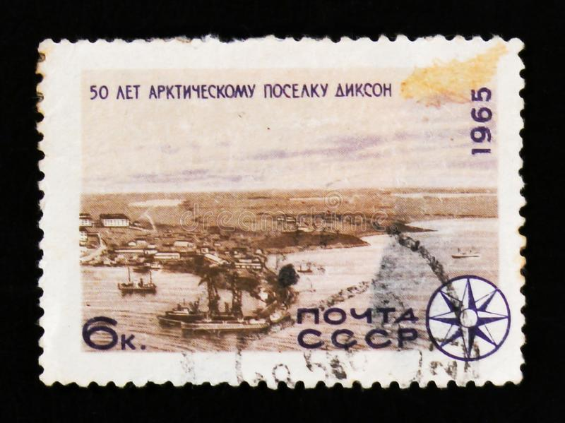 An arctic village of Dixon, 50th years anniversary, circa 1965. MOSCOW, RUSSIA - JUNE 26, 2017: A stamp printed in USSR Russia shows an arctic village of Dixon royalty free stock images