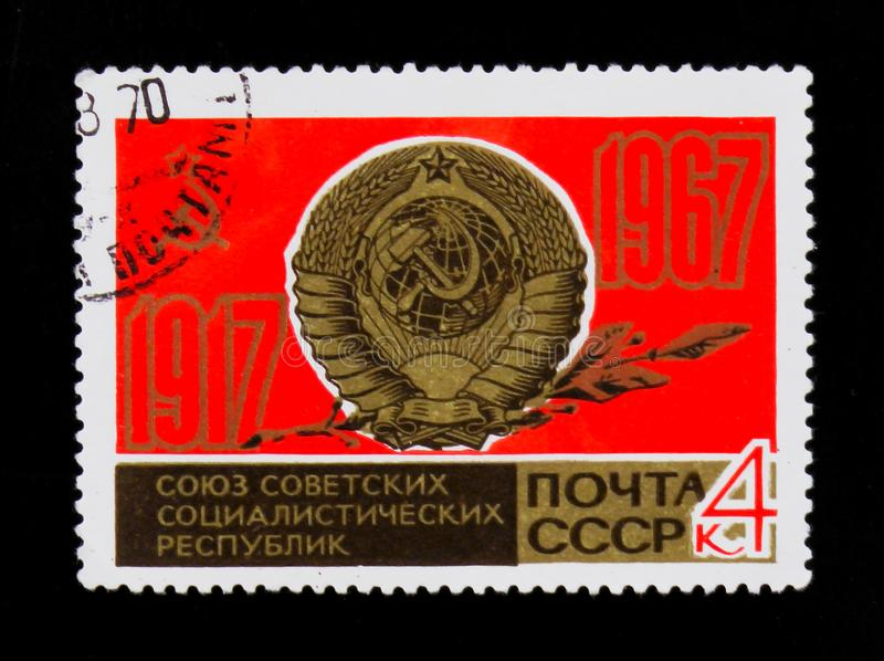 Coat of arms of USSR, 50th anniversary, circa 1967. MOSCOW, RUSSIA - JUNE 26, 2017: A stamp printed in USSR Russia shows coat of arms of USSR, 50th anniversary royalty free stock image