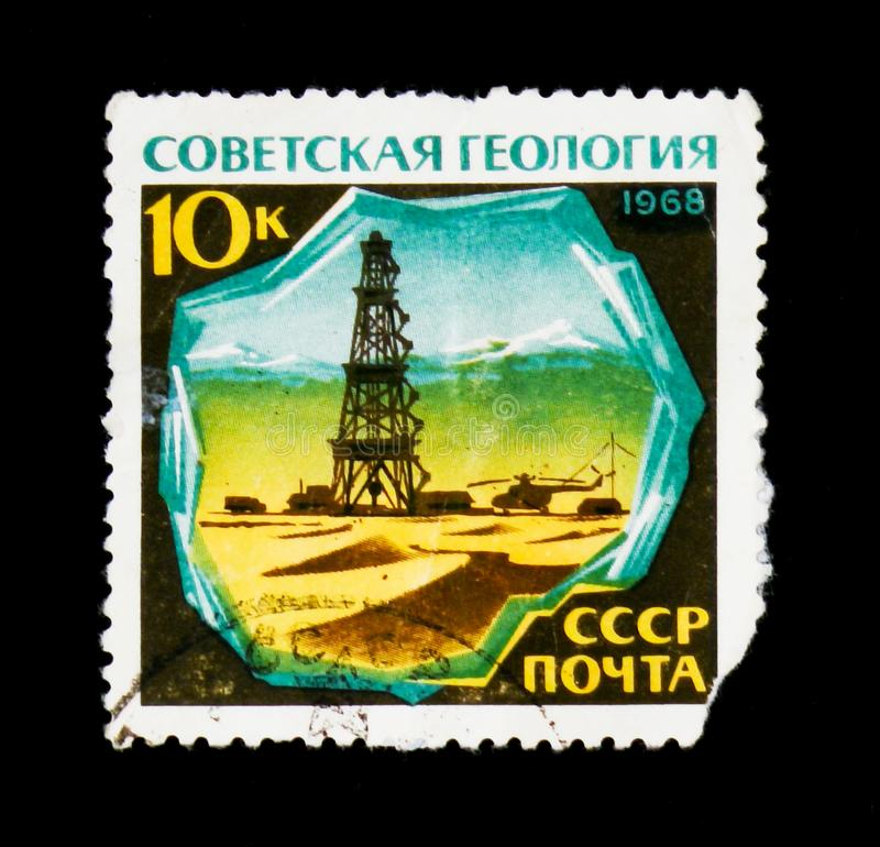 Geology, oil, petroleum tower, circa 1968. MOSCOW, RUSSIA - JUNE 26, 2017: A stamp printed in USSR Russia shows geology, oil, petroleum tower, circa 1968 royalty free stock photography