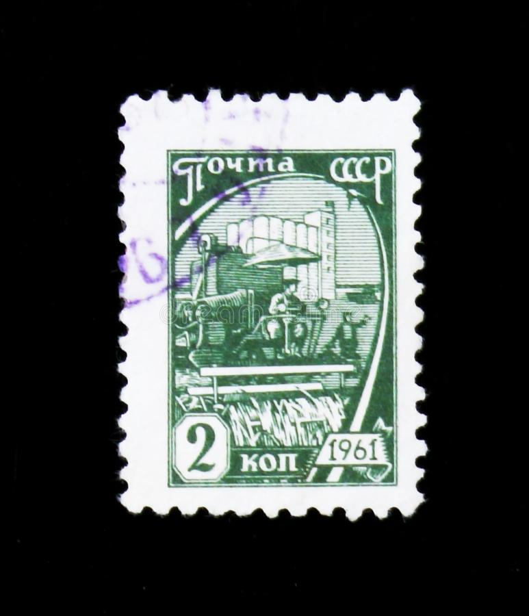 Harvester and silo, series, circa 1961. MOSCOW, RUSSIA - JUNE 26, 2017: A stamp printed in USSR Russia shows a harvester and silo, series, circa 1961 stock photography