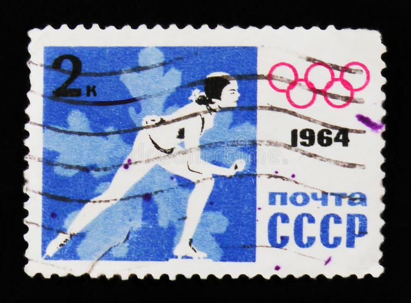 A skater, IX winter Olympic Game, circa 1964 royalty free stock image