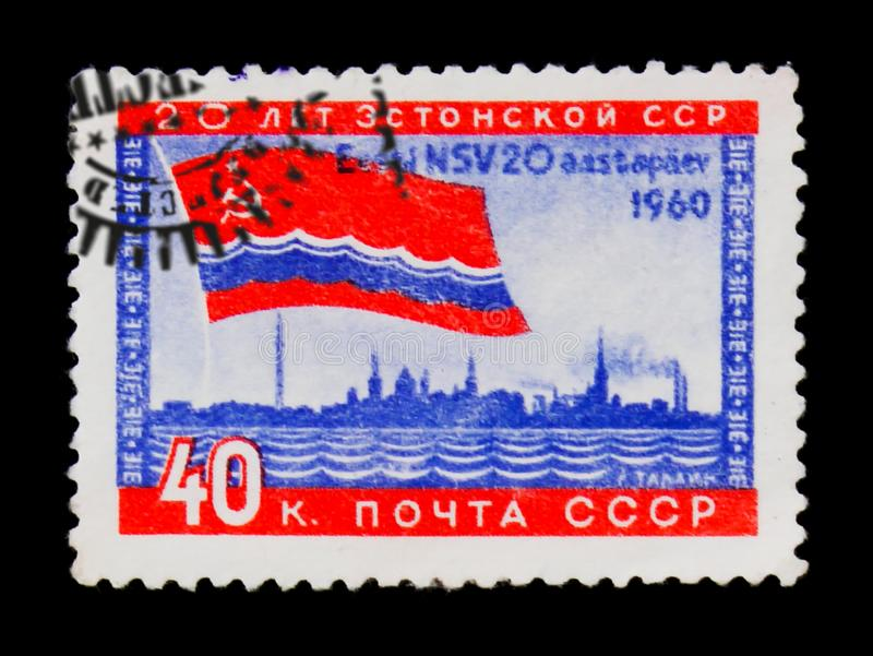 Soviet red flag and sea, 20 years of Estonian republic, circa 1960. MOSCOW, RUSSIA - JUNE 26, 2017: A stamp printed in USSR Russia shows soviet red flag and sea stock photos