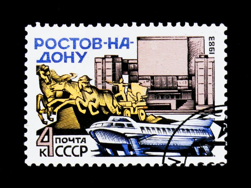 Rostov-on-Don, motorboat, monument and facade building, circa 1983. MOSCOW, RUSSIA - JUNE 26, 2017: A stamp printed in USSR Russia shows image of the Rostov-on royalty free stock image