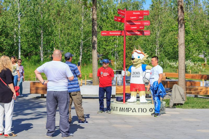 Moscow, Russia - June 03, 2018: Tourists from Asia taking pictures with the official symbol of FIFA World Cup Russia 2018 wolf Zab royalty free stock photo
