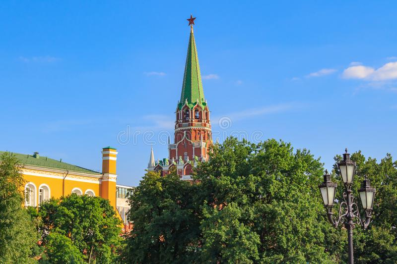 Moscow, Russia - June 28, 2018: Tower and building of Moscow Kremlin against blue sky and green trees in sunny day stock photo