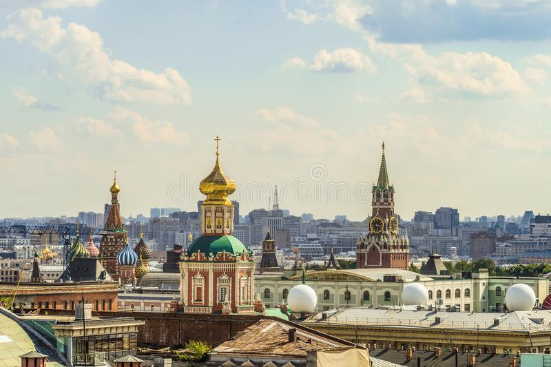 View of the chimes of the Spassky Tower, the Temple of the Epiphany and the Cathedral of St. Basil the Blessed stock photos