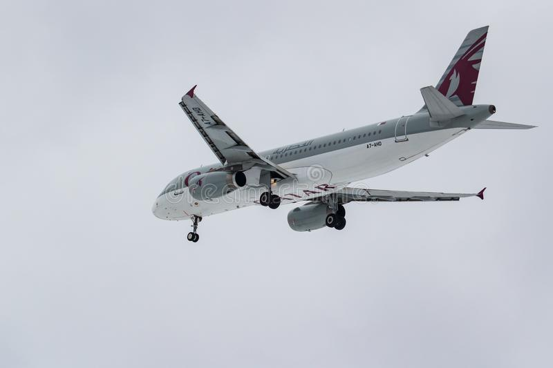 Moscow, Russia - March 17, 2019: Aircraft Airbus A320-232 A7-AHD of Qatar Airways going to landing at Domodedovo international. Airport in Moscow against gray stock photos