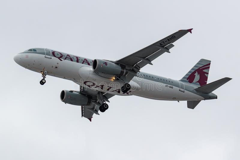 Moscow, Russia - March 17, 2019: Aircraft Airbus A320-232 A7-AHD of Qatar Airways going to landing at Domodedovo international. Airport in Moscow against gray royalty free stock images