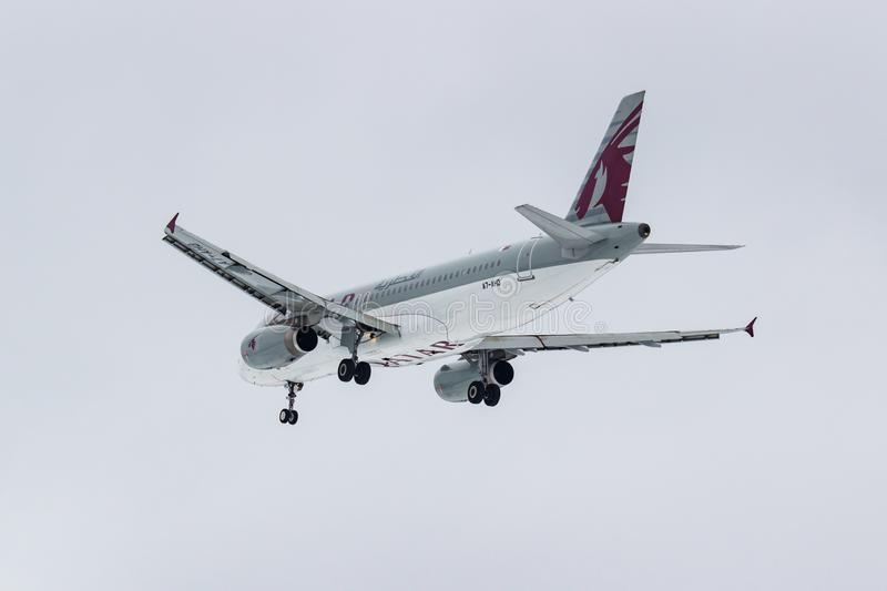 Moscow, Russia - March 17, 2019: Aircraft Airbus A320-232 A7-AHD of Qatar Airways going to landing at Domodedovo international. Airport in Moscow against gray stock image