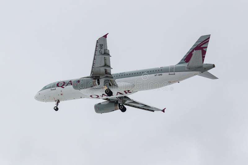 Moscow, Russia - March 17, 2019: Aircraft Airbus A320-232 A7-AHD of Qatar Airways going to landing at Domodedovo international. Airport in Moscow against gray royalty free stock photography