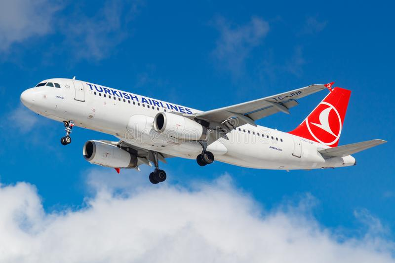 Moscow, Russia - March 26, 2019: Aircraft Airbus A320-232 TC-JUF of Turkish Airlines against blue sky in sunny morning going to. Landing at Vnukovo royalty free stock photography