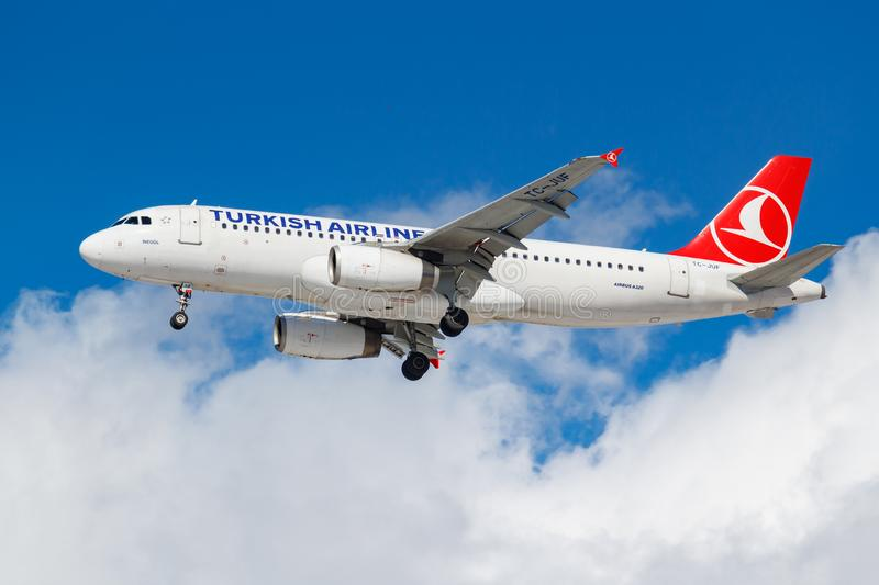 Moscow, Russia - March 26, 2019: Aircraft Airbus A320-232 TC-JUF of Turkish Airlines against blue sky in sunny morning going to. Landing at Vnukovo royalty free stock image