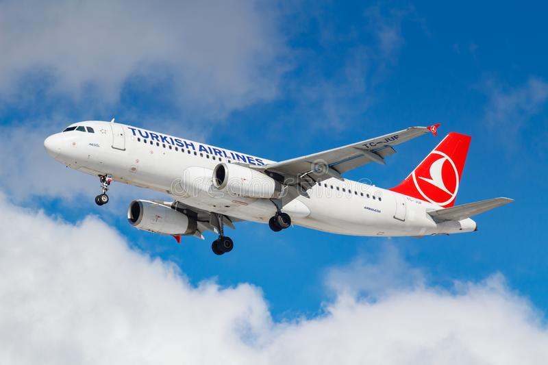 Moscow, Russia - March 26, 2019: Aircraft Airbus A320-232 TC-JUF of Turkish Airlines against blue sky in sunny morning going to. Landing at Vnukovo royalty free stock photo