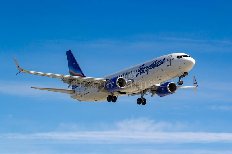 Moscow, Russia - March 14, 2019: Aircraft Boeing 737-800 VQ-BIZ of Yakutia Airlines going to landing at Vnukovo airport in Moscow. On a blue sky background at stock photo