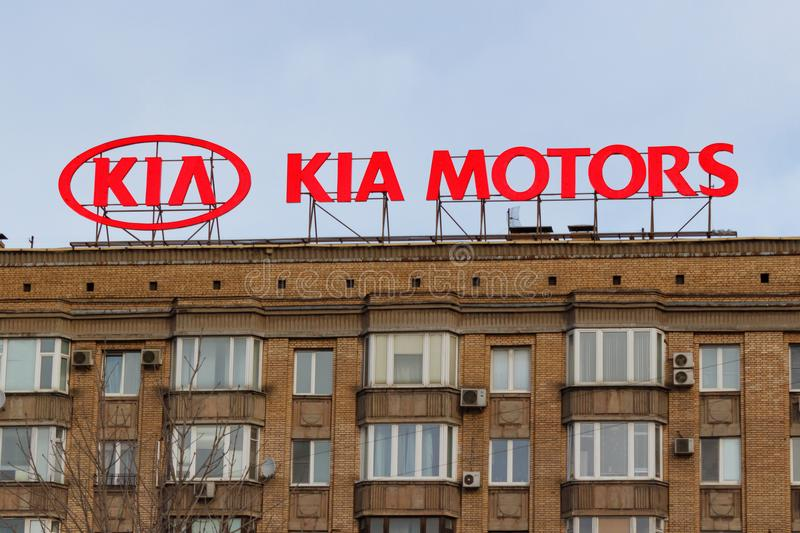 Moscow, Russia - March 25, 2018: Billboard with logo of korean car manufacturer KIA Motors on the building roof stock images