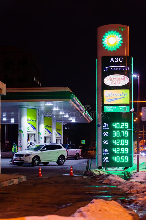 MOSCOW, RUSSIA - MARCH 20, 2018: The BP Connect filling station on the highway in the busy Moscow district at night. The LED display shows the prices of fuel royalty free stock photos
