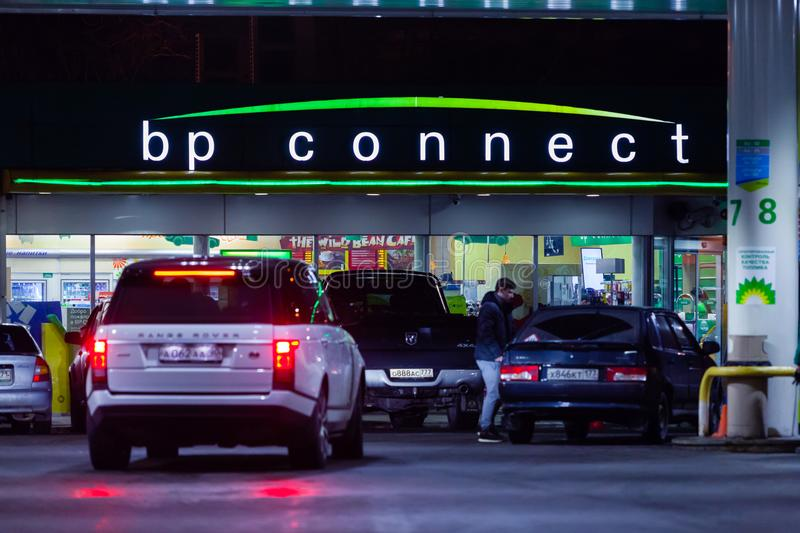 MOSCOW, RUSSIA - MARCH 20, 2018: The car drove up to the BP Connect petrol station on the highway in the busy Moscow. District in the evening. The LED display royalty free stock photography