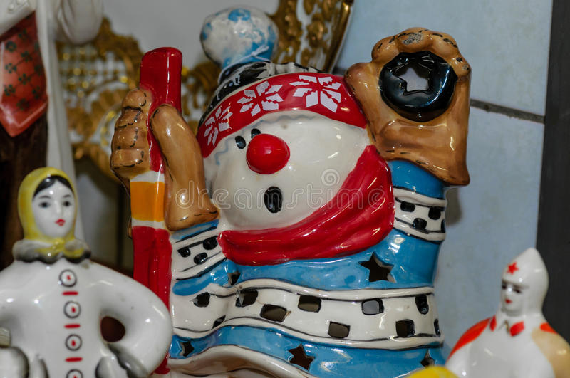 Moscow, Russia - March 19, 2017: Ceramic lamp in the form of a cartoon character, hockey player, snowman-goalkeeper royalty free stock photography