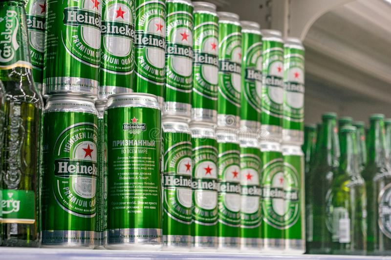 Moscow, Russia - March 12, 2018: Display with heineken of in cans in supermarket Lenta. One of largest retailer in royalty free stock photography