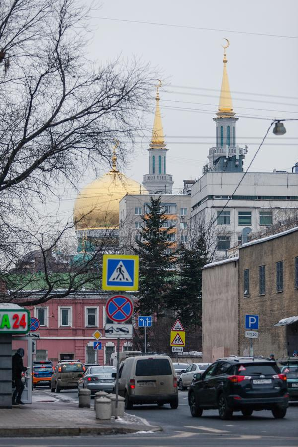 MOSCOW, RUSSIA - MARCH 12, 2018: The gilded domes of the mosque towering above the buildings of Moscow. stock image