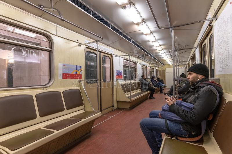 Moscow, Russia - March 9. 2019. Interior of subway car with passengers royalty free stock photos