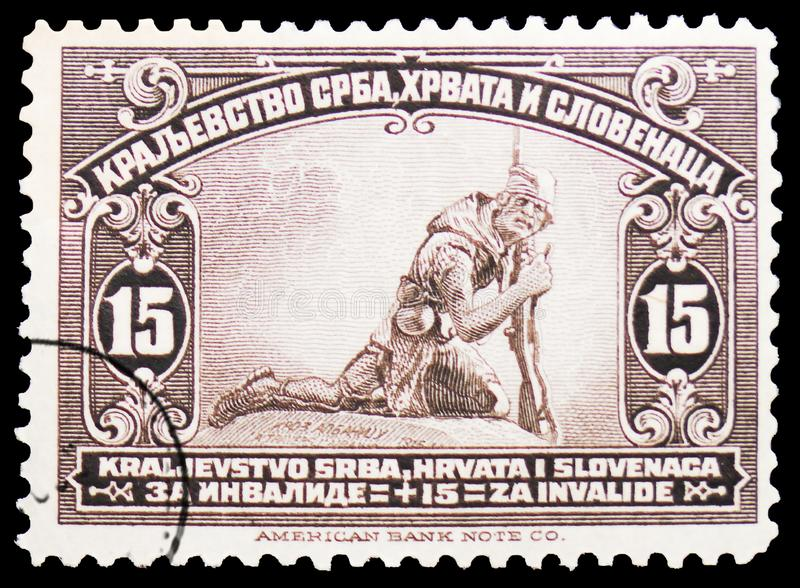 Wounded Serbian Soldier, Issue for the whole Kingdom serie, circa 1922. MOSCOW, RUSSIA - MARCH 23, 2019: Postage stamp printed in Kingdom of Serbs, Croats and stock photo