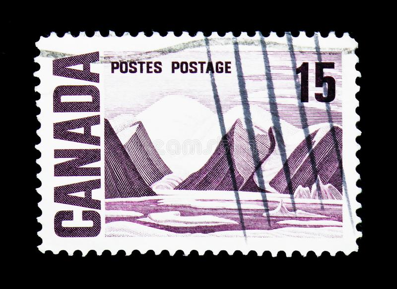 Bylot Island by Lawren Stewart Harris, Centennial Definitives -. MOSCOW, RUSSIA - MARCH 18, 2018: A stamp printed in Canada shows Bylot Island by Lawren Stewart royalty free stock image