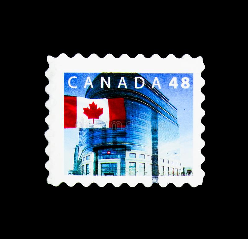 Flag in front of Canada Post Ottawa, Definitives 1989-2005: Canadian Flag serie, circa 2002. MOSCOW, RUSSIA - MARCH 18, 2018: A stamp printed in Canada shows stock photography