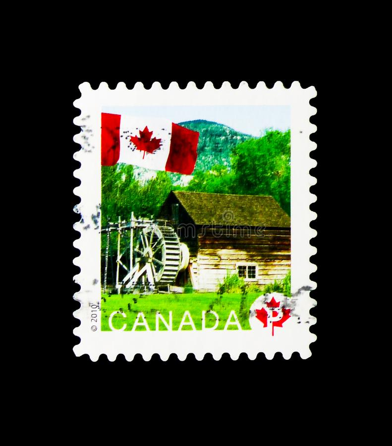 Keremeos Grist Mill, Flag Definitives serie, circa 2010. MOSCOW, RUSSIA - MARCH 18, 2018: A stamp printed in Canada shows Keremeos Grist Mill, Flag Definitives royalty free stock photos