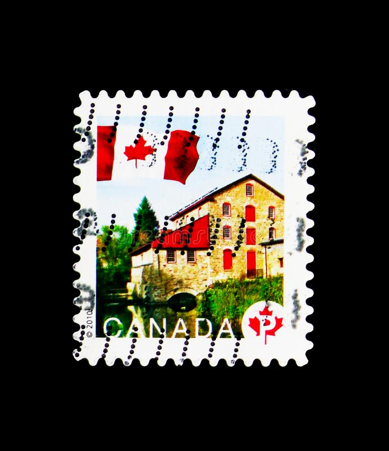 Old Stone Mill, Flag Definitives serie, circa 2010. MOSCOW, RUSSIA - MARCH 18, 2018: A stamp printed in Canada shows Old Stone Mill, Flag Definitives serie stock image