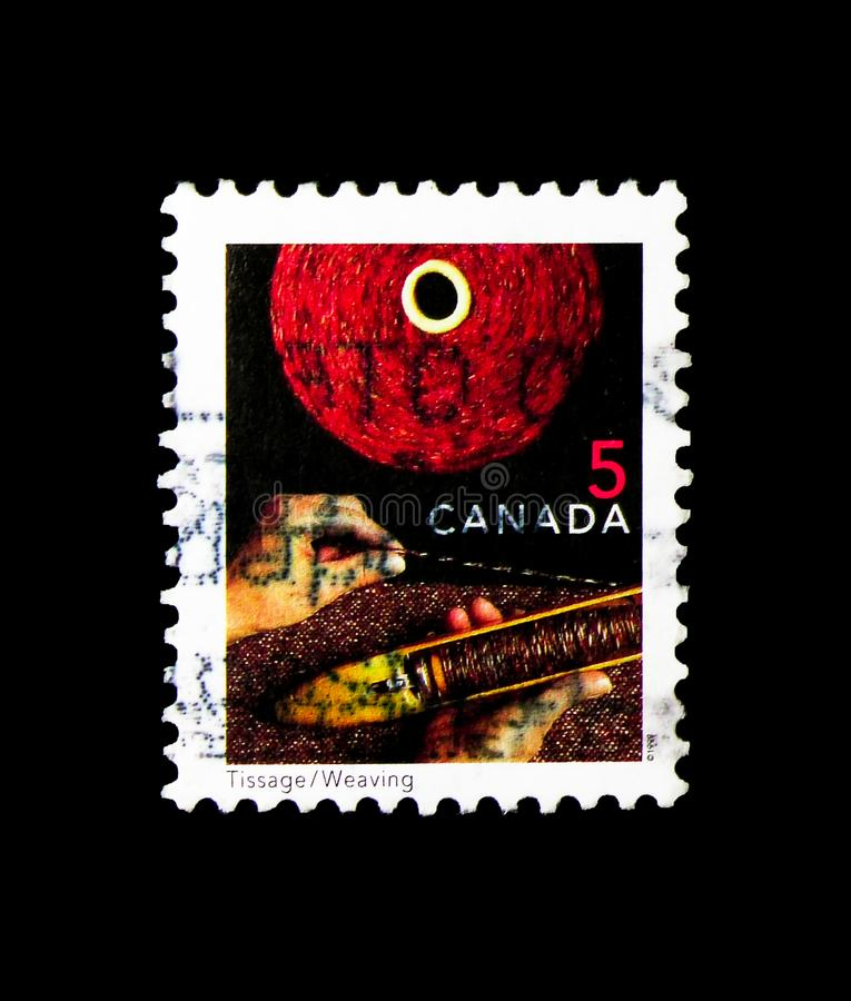 Weaving, Traditional Trades Definitives 1999-2002serie, circa 1999. MOSCOW, RUSSIA - MARCH 18, 2018: A stamp printed in Canada shows Weaving, Traditional Trades royalty free stock photography