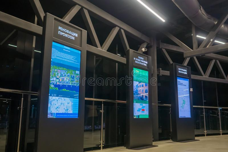 Electronic kiosks with touchscreen displays at modern trade show or exhibition. MOSCOW, RUSSIA - March 1, 2019: Three electronic kiosks with touchscreen stock image