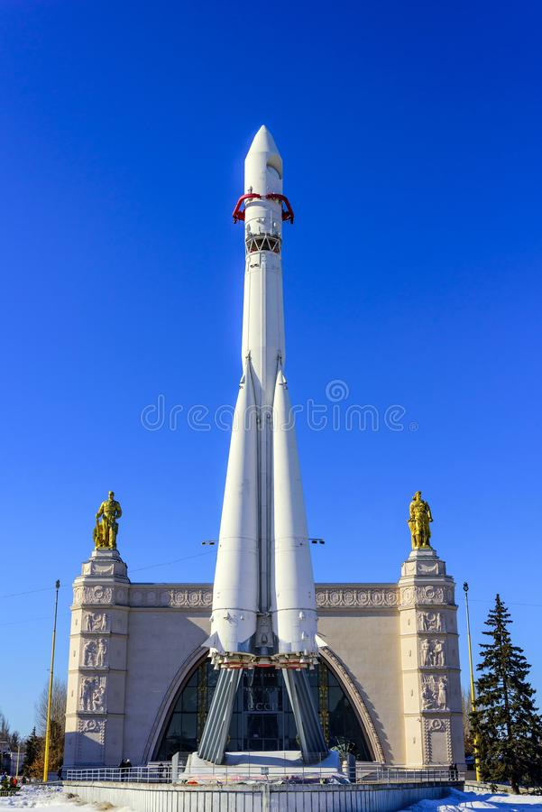 Moscow, Russia-March 24, 2018: Vostok spaceship in the background of the Space pavilion at VDNKh.  royalty free stock image