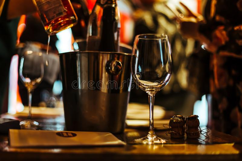 Moscow, Russia-March 30, 2019: wine tasting: an empty glass stands on the tasting table next to brochures, champagne corks and sil. Ver buckets in which the royalty free stock images