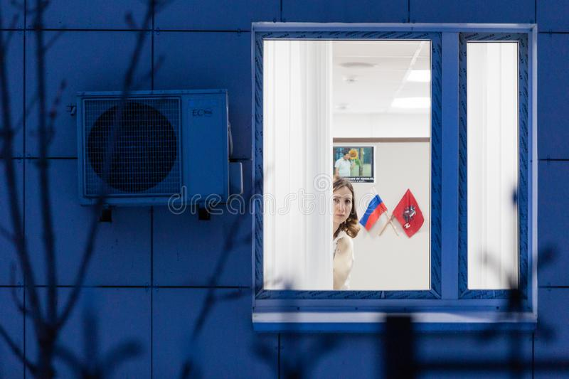 MOSCOW, RUSSIA - MARCH 20, 2018: A woman working in the center of public services. `My Documents` looks out the window. These centers are located in each royalty free stock images