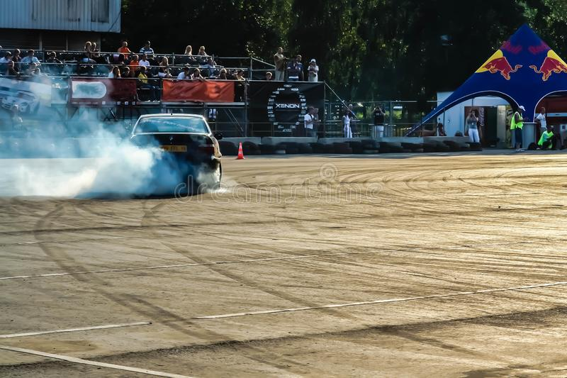 Moscow, Russia - May 25, 2019: Black Drift bmw. Tuned car drifting in the fenced area. Burnout. Back side.  stock photography