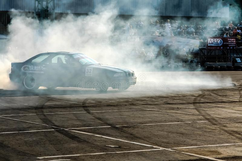 Moscow, Russia - May 25, 2019: Black Drift bmw. Tuned car drifting in the fenced area. Burnout. Right Side view.  stock image