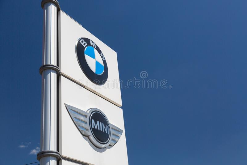 Moscow, Russia - May, 2018: BMW Mini Cooper group car manufacturer signage. Bavarian Motor Works, known as BMW is German luxury ve. Hicles and motorcycles royalty free stock photography