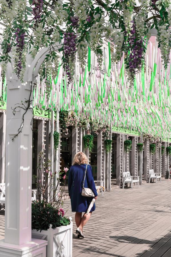 Moscow, Russia - May, 05, 19. Brigt beautiful flowers and pink,green, white ribbons fluttering in the wind on Tverskaya. Square. Moscow spring from Moscow royalty free stock image