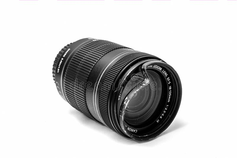 Moscow, Russia - May 13, 2019: Canon zoom tele foto lens 18-135mm with a broken protective UV glass filter on a white background. stock image