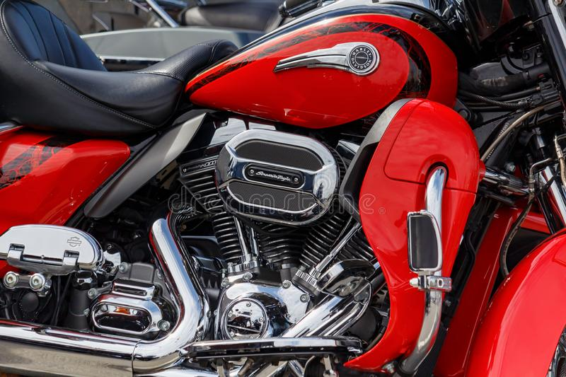 Moscow, Russia - May 04, 2019: Fragment of chrome engine with exhaust system pipes of Harley Davidson motorcycle. Moto festival royalty free stock images