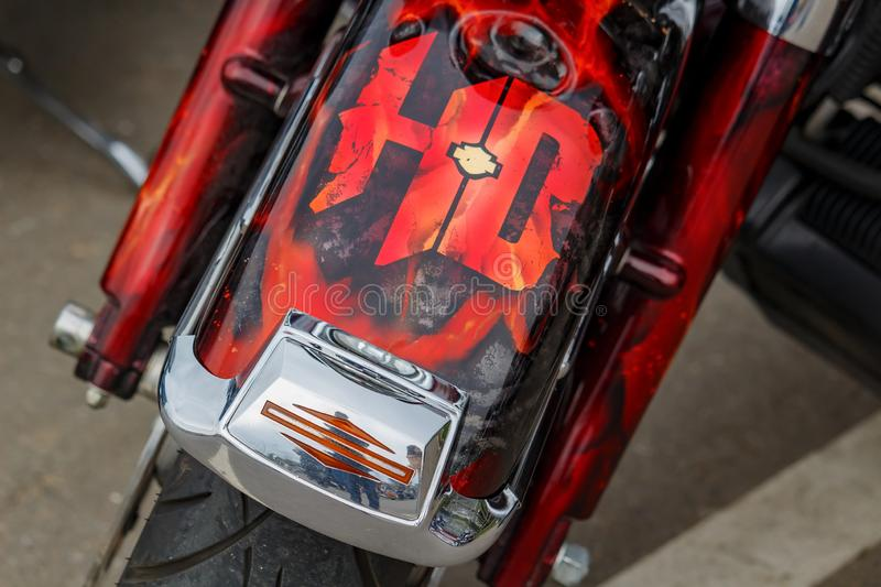 Moscow, Russia - May 04, 2019: Front fender with airbrushed Harley Davidson motorcycles emblem closeup. Moto festival MosMotoFest. 2019 stock photo