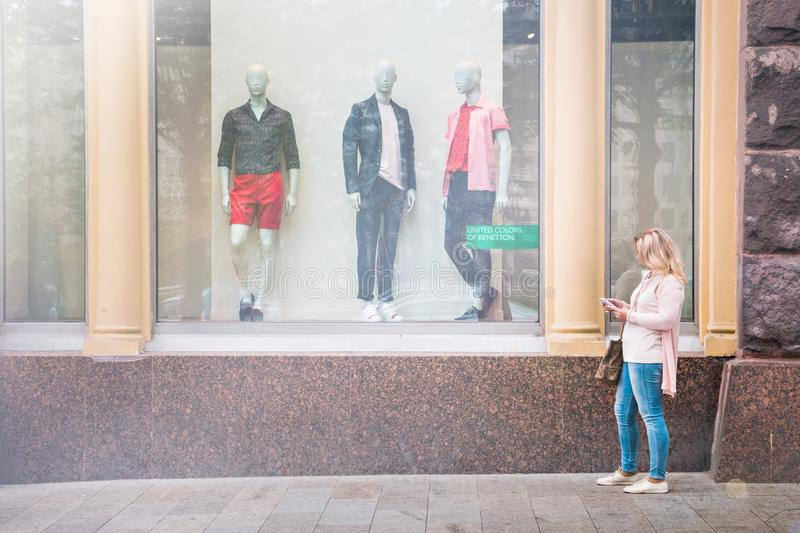 Moscow, Russia, May 22. 2018: the girl standing at the shop window of the famous brand royalty free stock photography